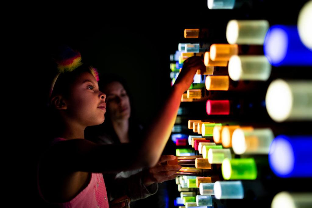 children playing with light up wall