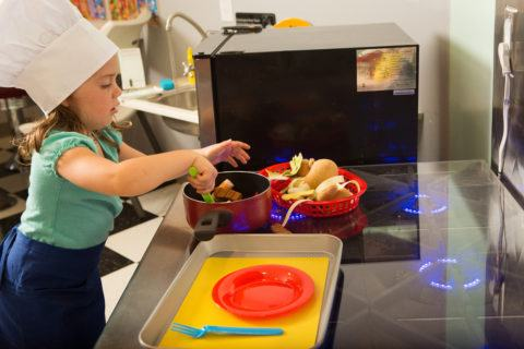 Child playing with Toy Oven