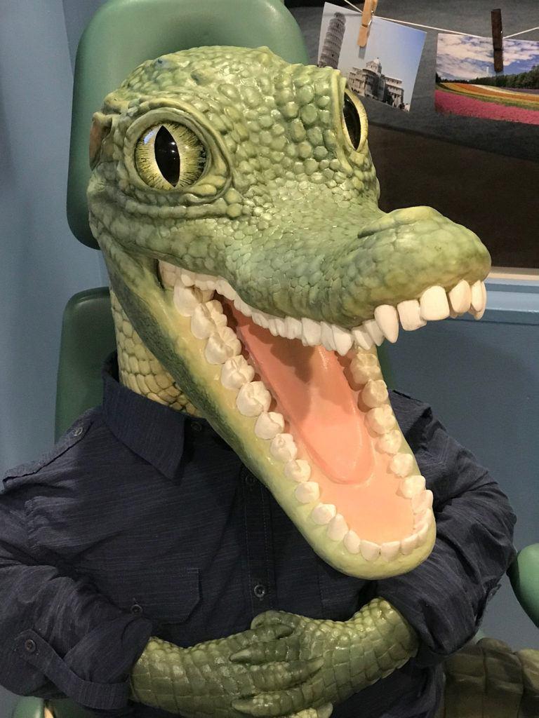 crocodile smiling in dental chair