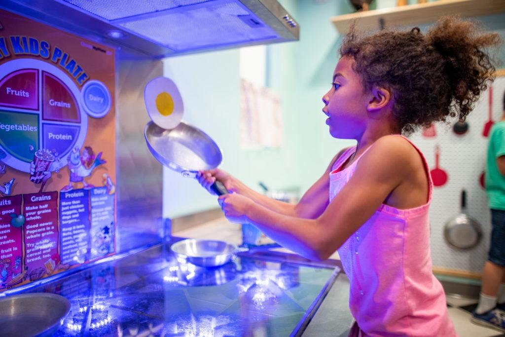 children playing in pretend kitchen