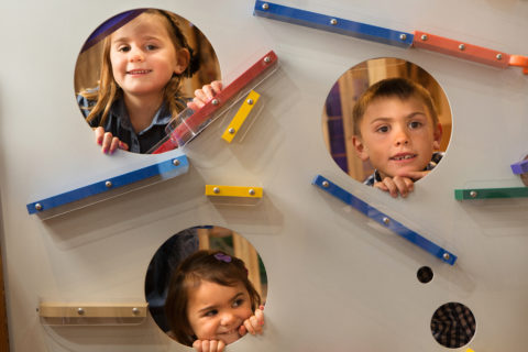 kids playing at magnetic ball wall