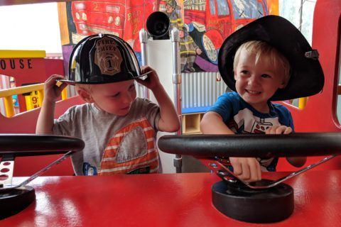twins in play fire truck