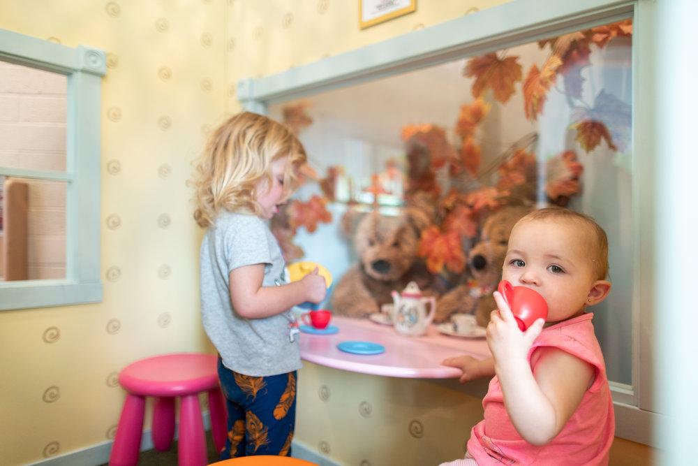 children using their imaginations at window exhibit