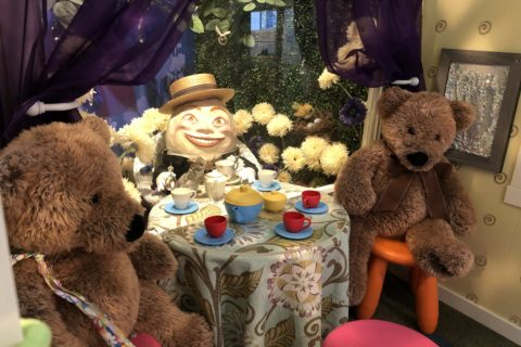 teddy bears in the storybook play cottage