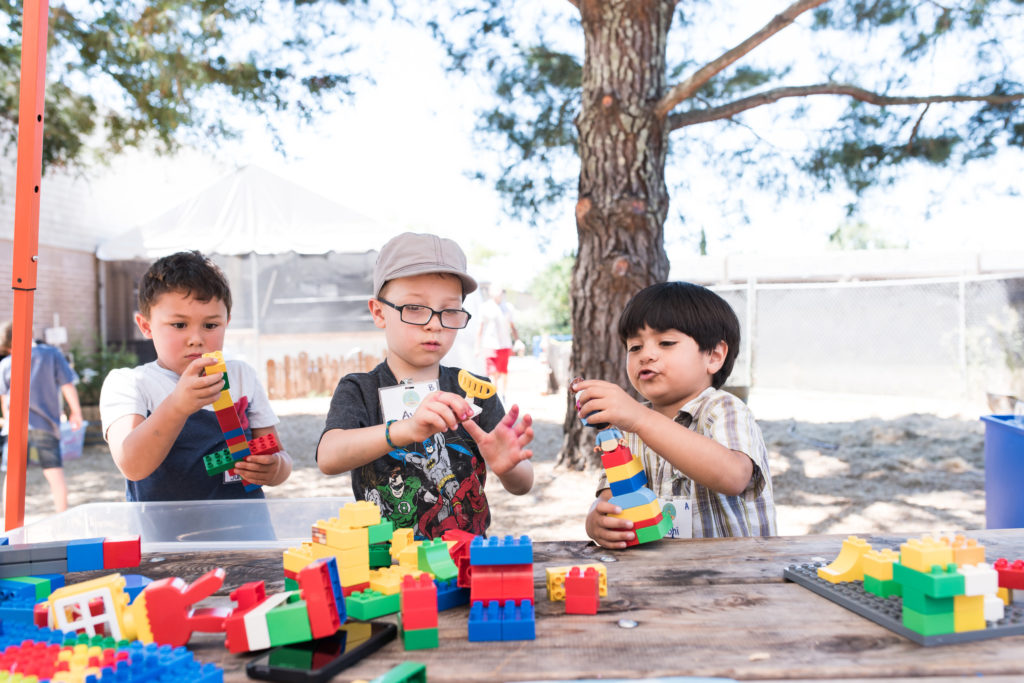 two children playing with blocks at wonder camp