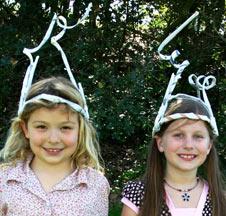 kids wearing pipe cleaner bug antennae