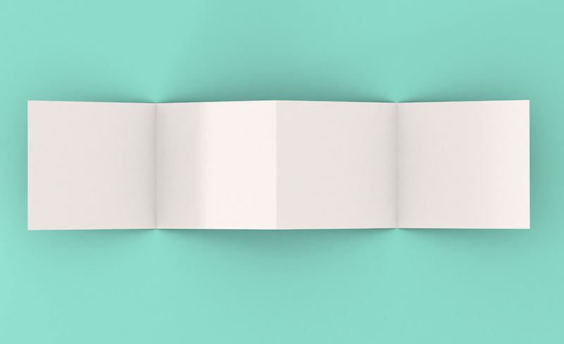 paper folded into an Accordion Book on teal background