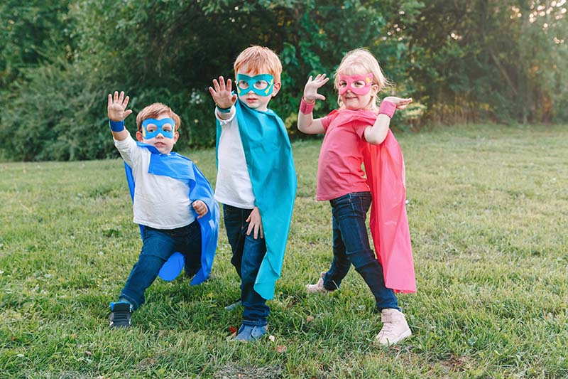 kids dressed up in homemade capes and superhero masks