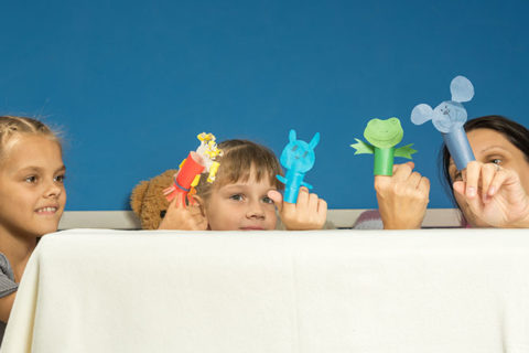 children and mom play with homemade paper finger puppets