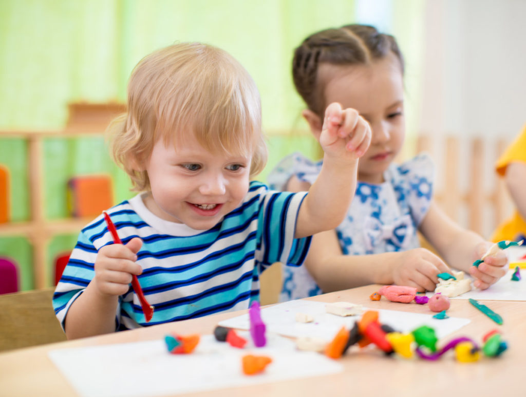 two toddler children playing with homemade playdough
