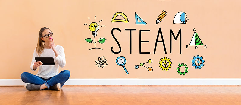 STEAM with woman using a tablet