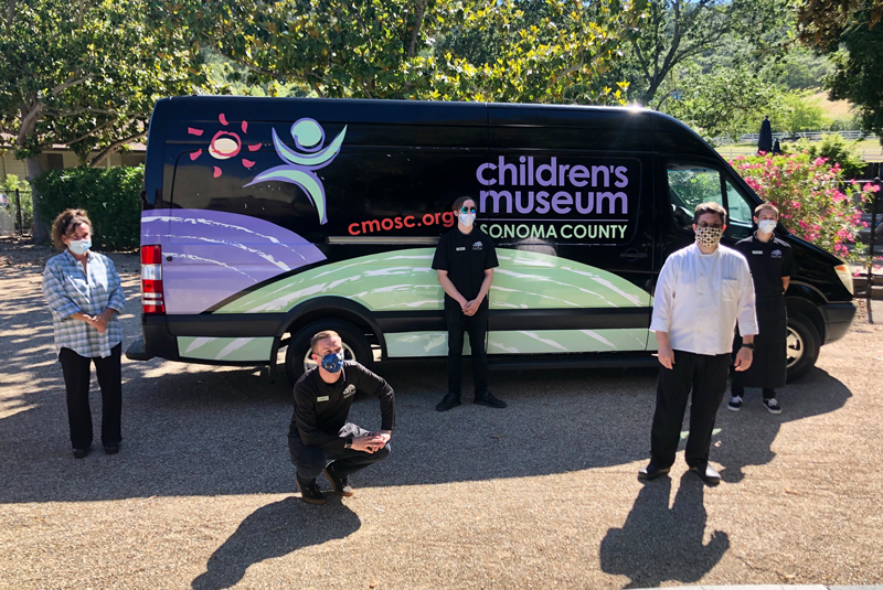 childrens museum staff socially distanced in front of van