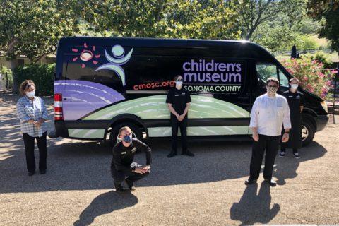 volunteers standing in front of van