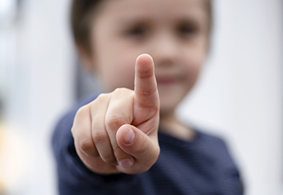 child pointing with index finger