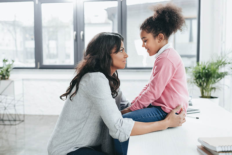 mother and daughter at home having a conversation