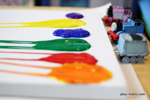 paint drops with toy trains
