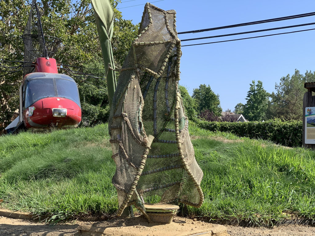 large chrysalis made from netting and pipes