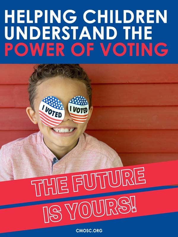 young child smiling and wearing 'I Voted' stickers on his face
