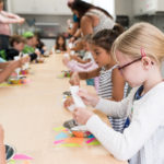 children building craft projects while at camp