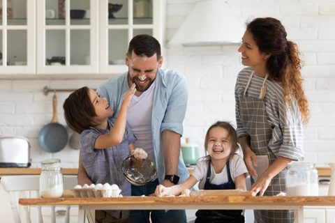 family of four cooking Kid-Friendly Holiday Recipes From Around the World