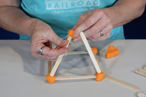 a 3D shape handmade out molding clay and craft sticks from the Children's Museum of Sonoma County's Creative Construction kit and caboodles