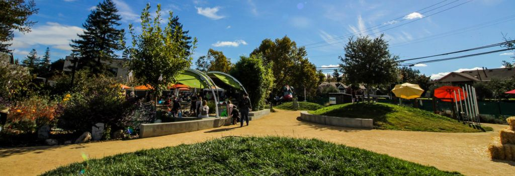 Wide view of the outdoor exhibit area called Mary's Garden at the Children's Museum of Sonoma County.