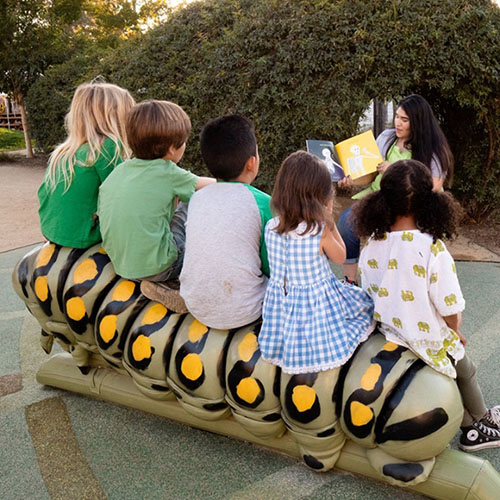 children enjoying Storytime at the Children's Museum of Sonoma County sitting on the Storybook Caterpillar