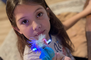 girl playing with electric bling toy