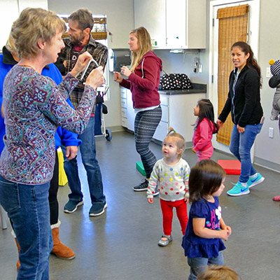 Nancy Nelle instructing toddlers Musical Moments program at the Children's Museum of Sonoma County